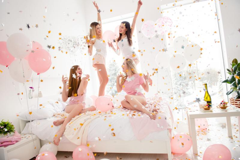 hen party weekend package with hens having fun with balloons and prosecco